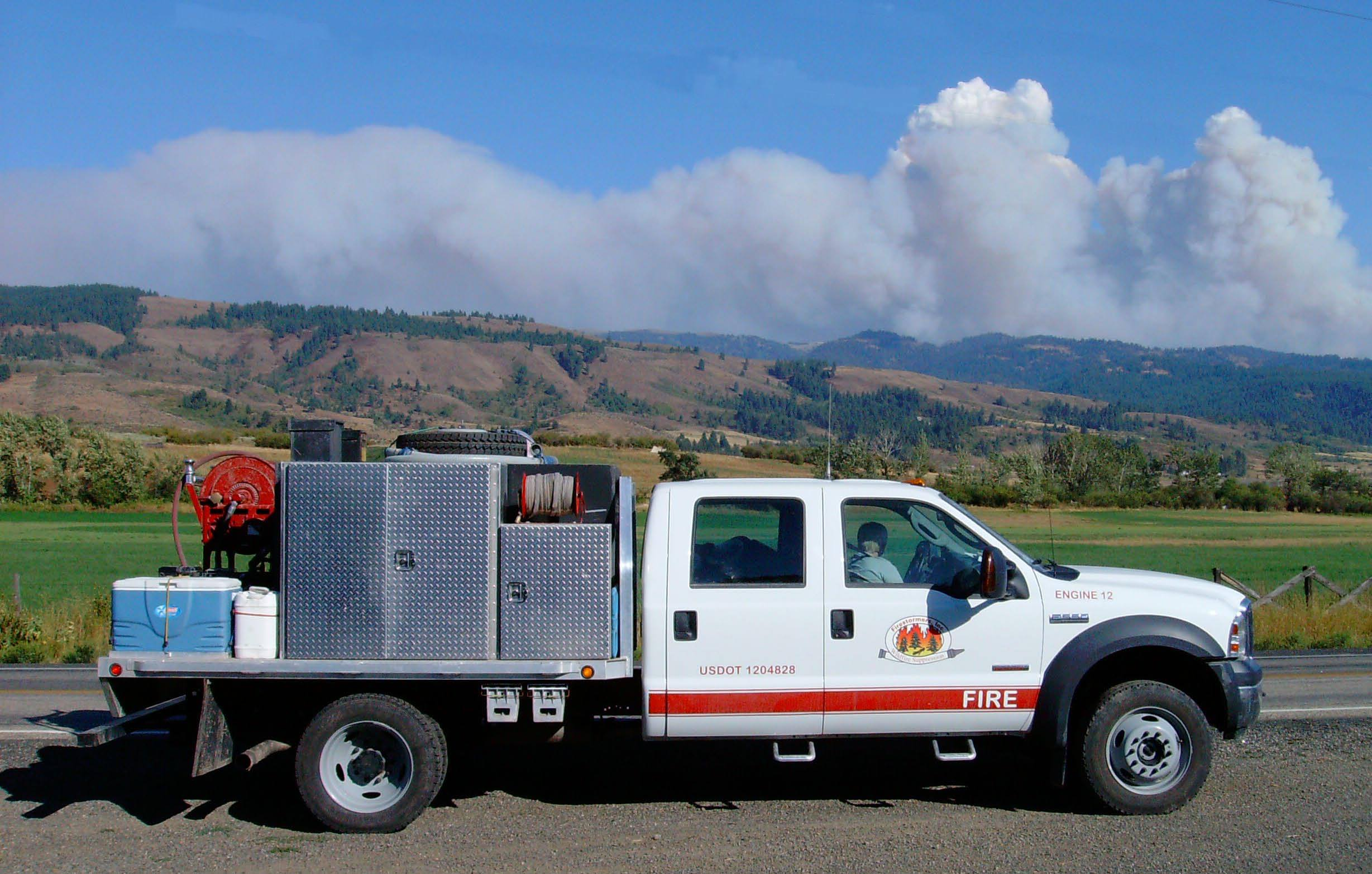 Fire crew stopped in Idaha for a photo opportunity with a large fire Defensive Eco- __fg_link_0__  courses both reduce incidents and improve fuel efficiency. in the background.